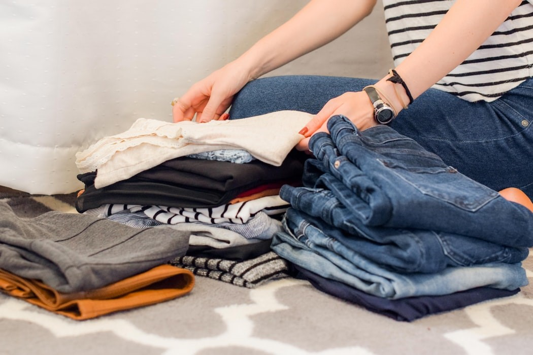 Woman folding the garments the right way